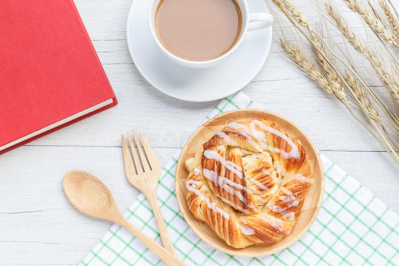 Danish pastries, coffee and note book on white wooden table. Top view danish pastries, coffee and note book on white wooden table royalty free stock images