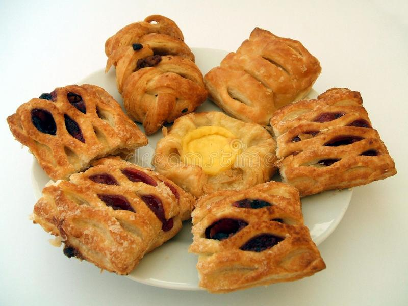 Danish pastries with custard and jam on a plate. Bakery or supermarket products of Danish pastry stock images