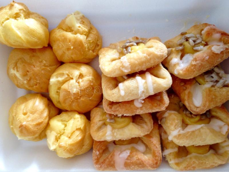 Danish pastries and eclair. Danish pastries with custard and eclair royalty free stock photos