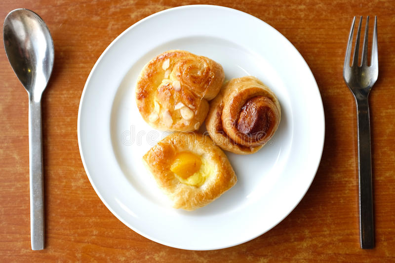 Danish Pastries. Fresh danish pastries filled with assorted fruits and nuts royalty free stock image