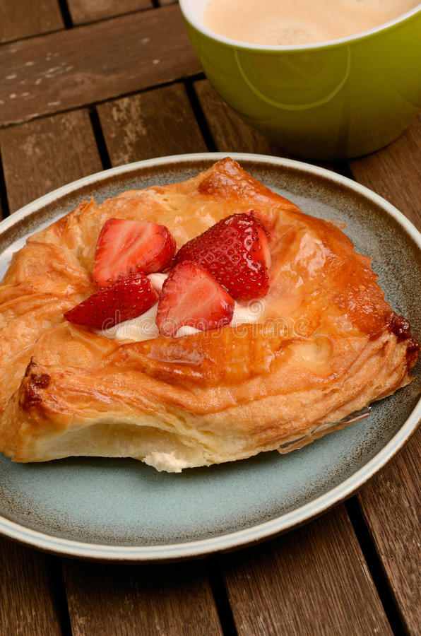 Danish pastry. With fresh strawberries royalty free stock photos