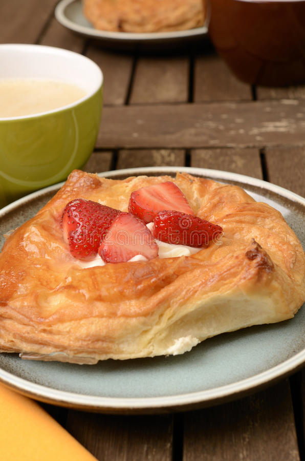 Danish pastry. With fresh strawberries stock images