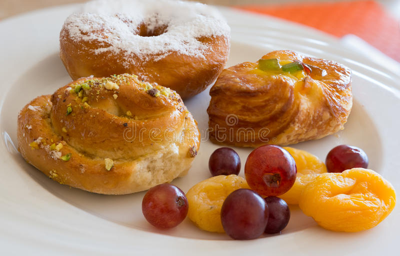 Danish pastry and fruits. On white dish,close-up stock images