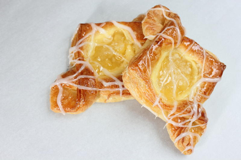 Danish pastry. Are made of flour, yeast, milk, eggs and butter stock photos