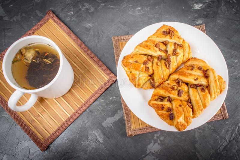 Danish pastry maple pecan with nuts and maple syrup. royalty free stock photo