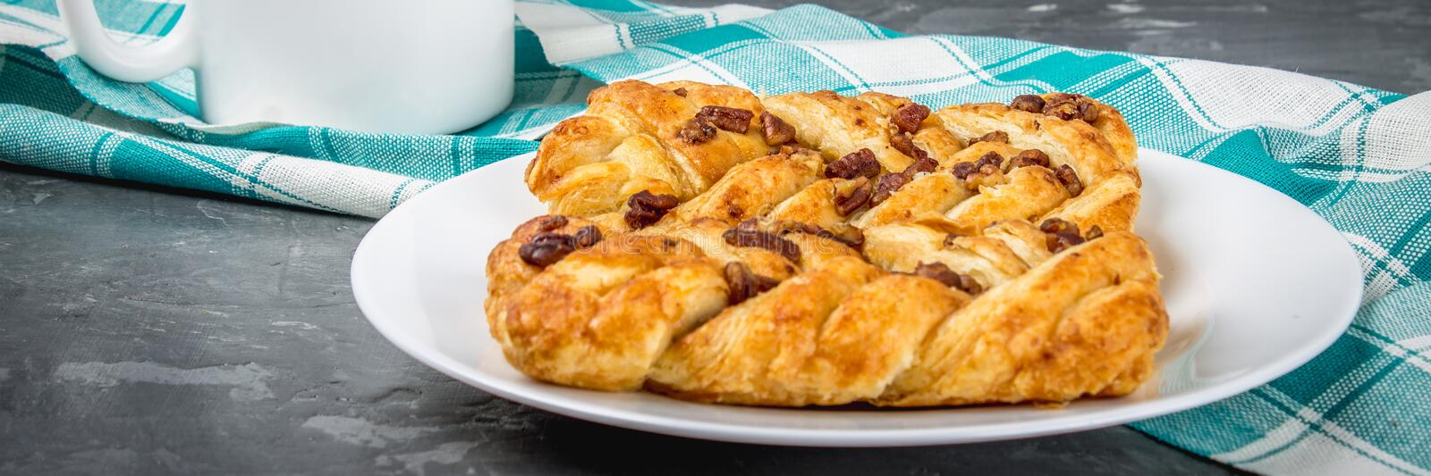Danish pastry maple pecan with nuts and maple syrup, banner stock image