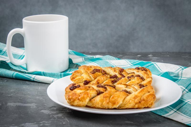 Danish pastry maple pecan with nuts and maple syrup. royalty free stock image