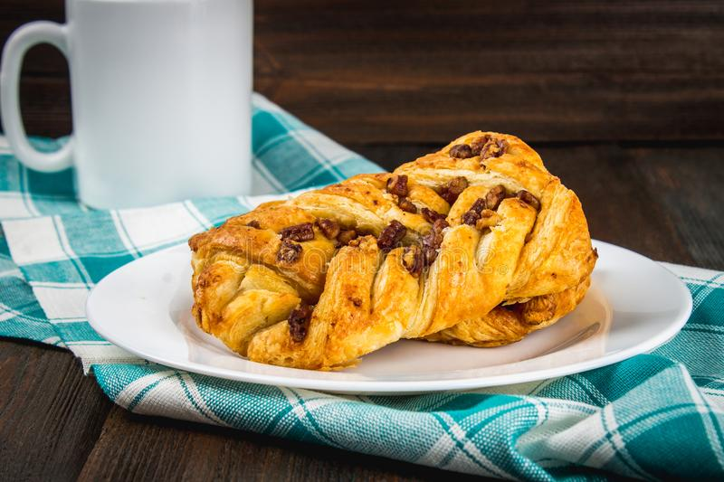 Danish pastry maple pecan with nuts and maple syrup. stock images