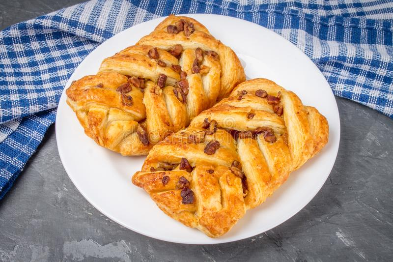 Danish pastry maple pecan with nuts and maple syrup. stock photos
