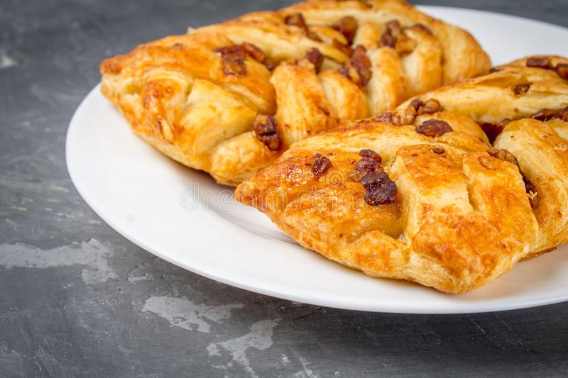 Danish pastry maple pecan with nuts and maple syrup. royalty free stock photos