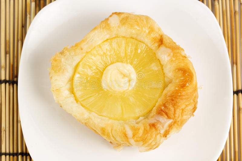 Danish pastry with pineapple royalty free stock photo