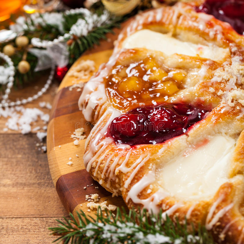 Danish Pastry Ring. With Cherry, Apple fruit and Cheese fillings. Selective focus royalty free stock photos