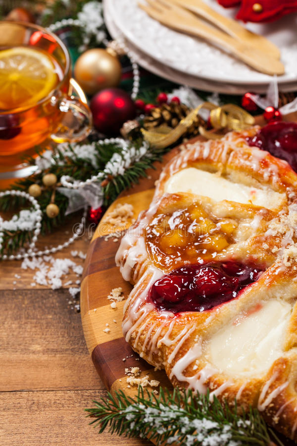 Danish Pastry Ring. With Cherry, Apple fruit and Cheese fillings. Selective focus stock photos