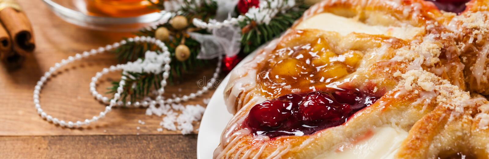 Danish Pastry Ring. With Cherry, Apple fruit and Cheese fillings. Selective focus stock image