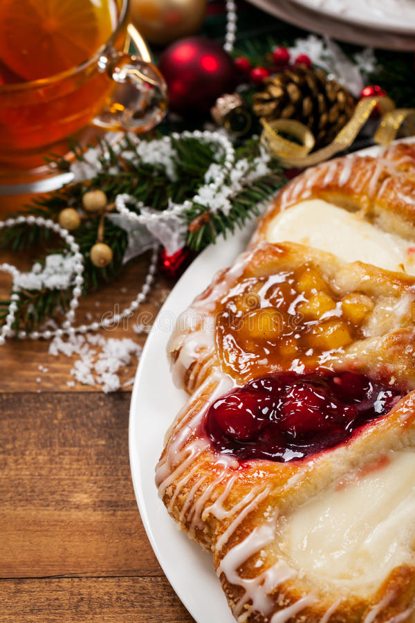 Danish Pastry Ring. With Cherry, Apple fruit and Cheese fillings. Selective focus stock photo