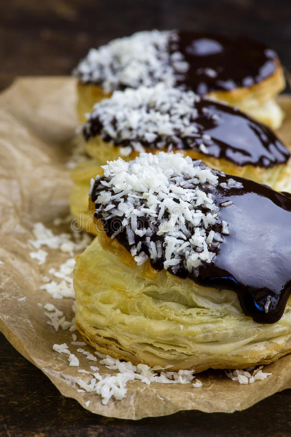Danish puff pastry stuffed doughnuts with coconut cream and choc royalty free stock photo