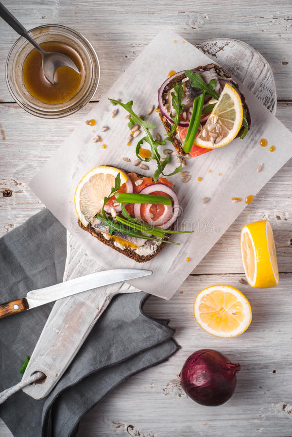 Danish sandwiches with fish sauce and mustard on a stand. Vertical royalty free stock photo