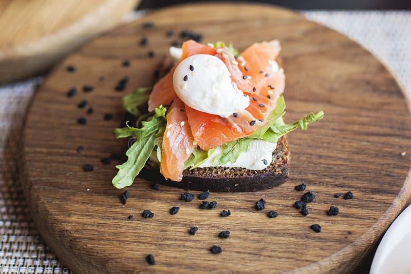 Danish smorrebrod on wooden board. Restaurant food. Traditional cuisine stock image