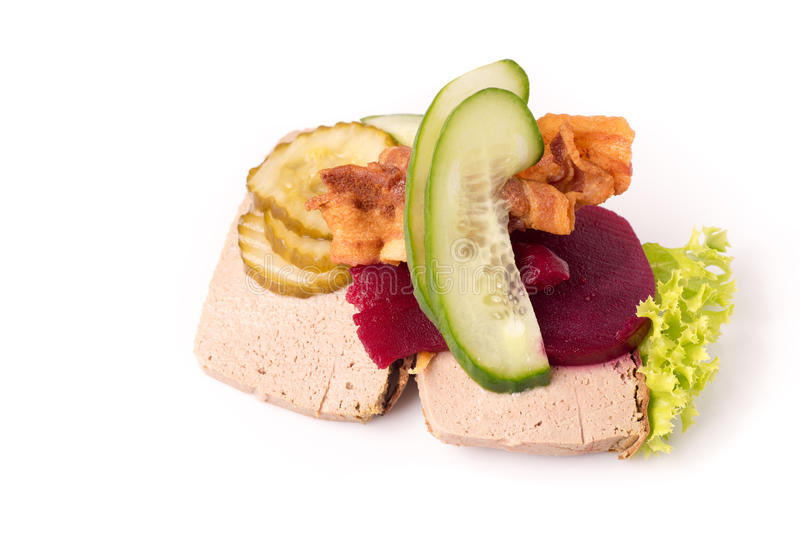 Danish specialties and national dishes, high-quality open sandwich. Liver Pate with bacon pickled cucumber, beetroot and cucumber on white background royalty free stock photo