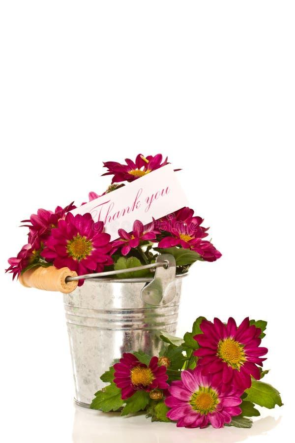 Dank mit Blumen lizenzfreies stockfoto