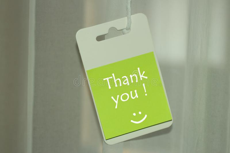 Dank u bericht met een glimlach stock afbeeldingen