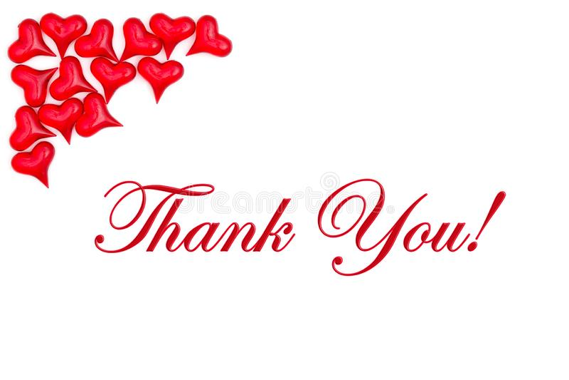 Dank u bericht met rode harten stock afbeelding