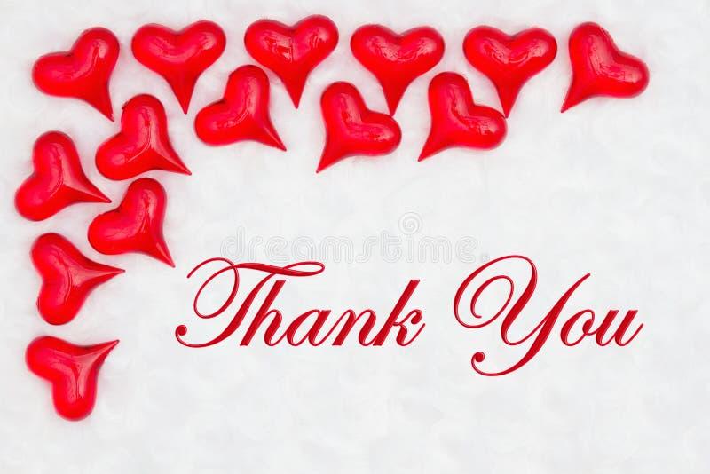 Dank u bericht met rode harten stock foto's