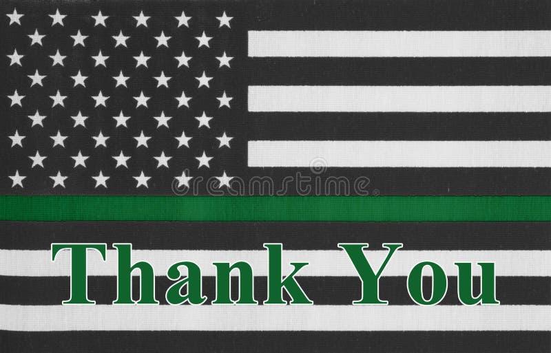 Dank u bericht op een Amerikaanse dunne groene lijnvlag stock foto