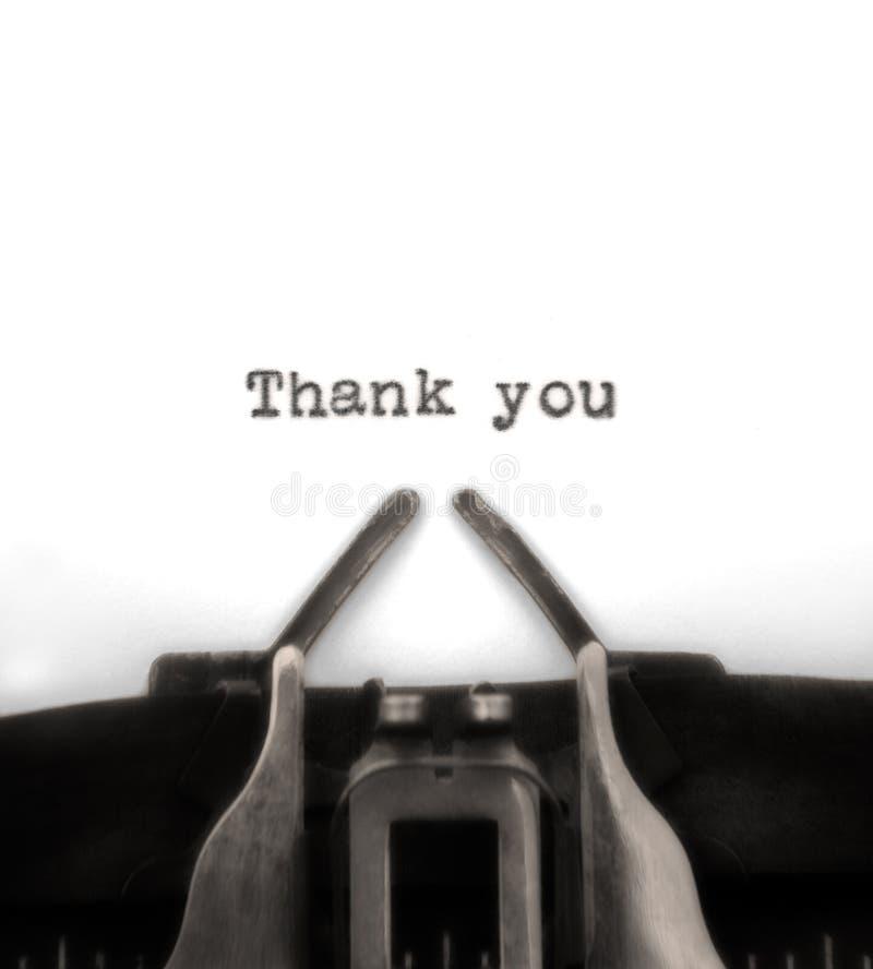 Dank u typte door Uitstekende Schrijfmachine stock afbeeldingen