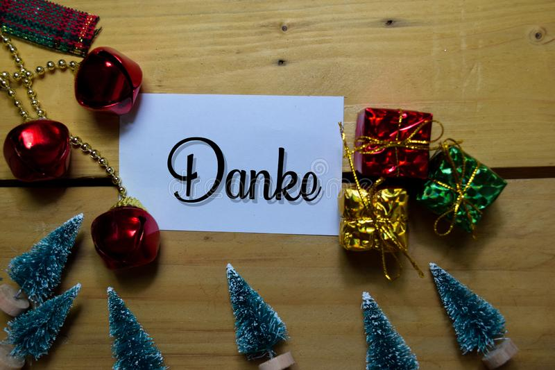 Danke write on label with wooden backgroud. It means Thank You. Frame of Christmas Decoration stock photo