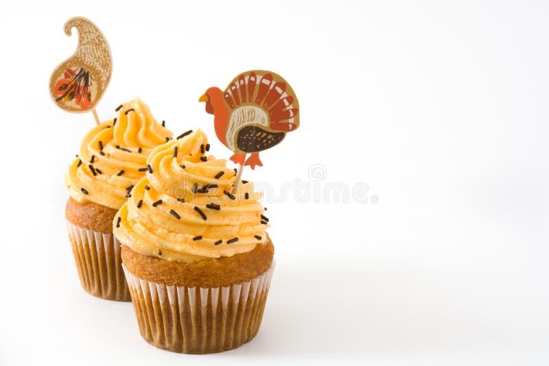 Dankzegging cupcakes op witte achtergrond stock afbeelding