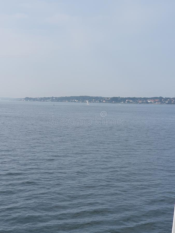 Danmark. Ocean, sky, lifetime, boats stock photos
