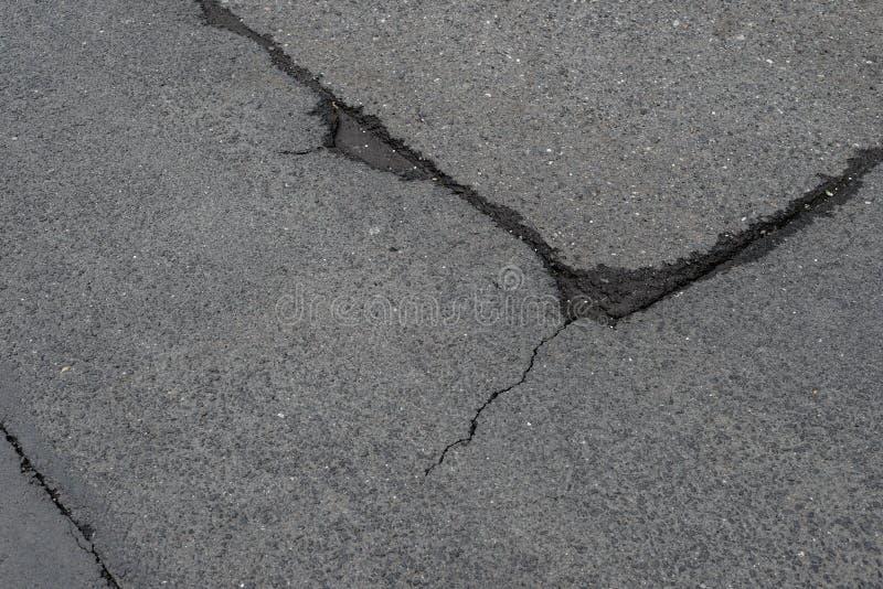 Danno della toppa della crepa della strada asfaltata fotografie stock