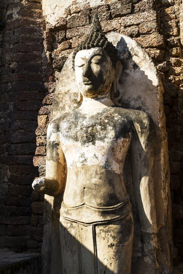 Dano e sunligh de buddha da escultura imagem de stock royalty free