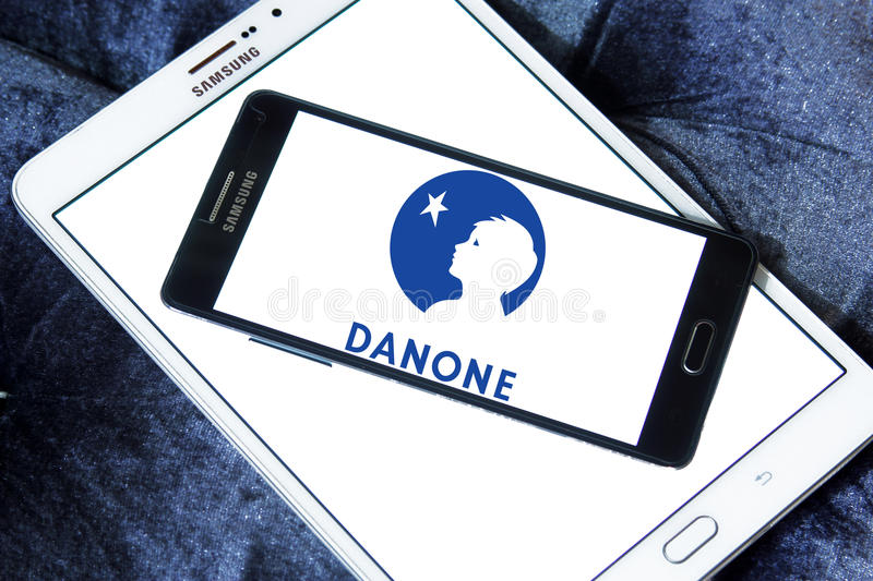 Danone logo. Logo of danone comany on samsung mobile phone.danone is a world leading food company built on four business lines: Fresh Dairy Products, Waters stock images