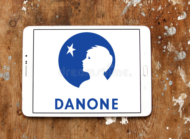 Danone logo. Logo of danone company on samsung tablet. danone is a world leading food company built on four business lines: Fresh Dairy Products, Waters, Early royalty free stock images