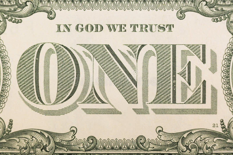 Dans Dieu nous faisons confiance - au billet de banque un plan rapproché du dollar images libres de droits