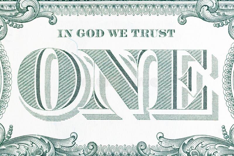 Dans Dieu nous faisons confiance - au billet de banque un plan rapproch? du dollar photo libre de droits