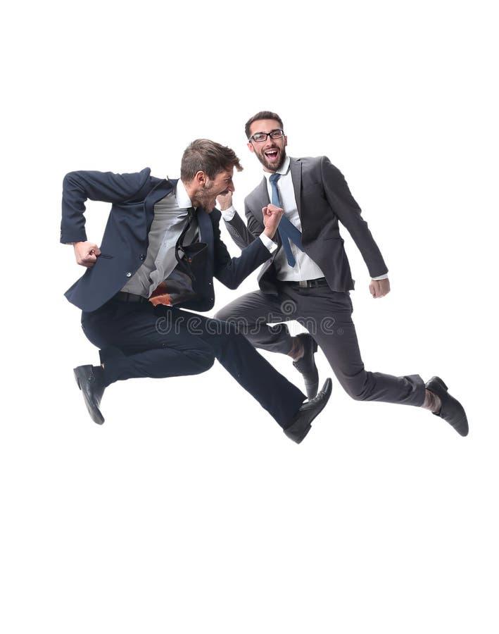 Dans la pleine croissance deux hommes d'affaires de danse gais photos stock