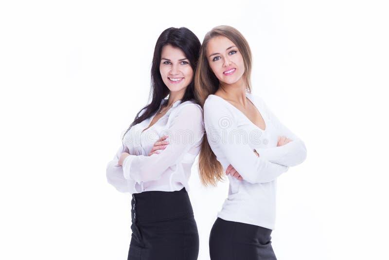Dans la pleine croissance Deux jeunes femmes d'affaires restant ensemble photo libre de droits