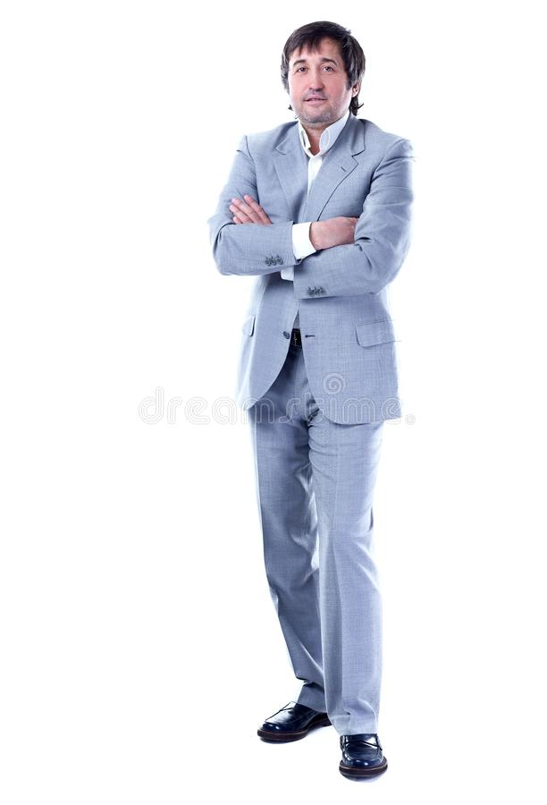 Dans la pleine croissance homme d'affaires sûr dans un costume gris D'isolement sur le blanc photo libre de droits