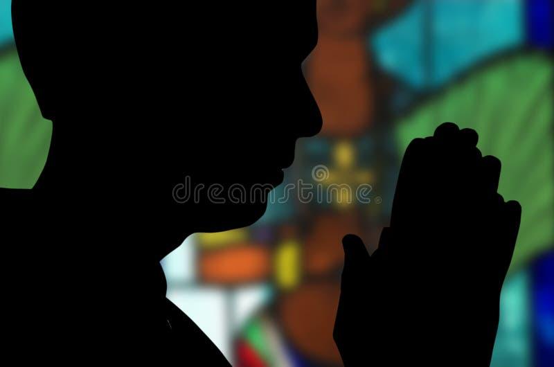 Dans la prière photographie stock libre de droits