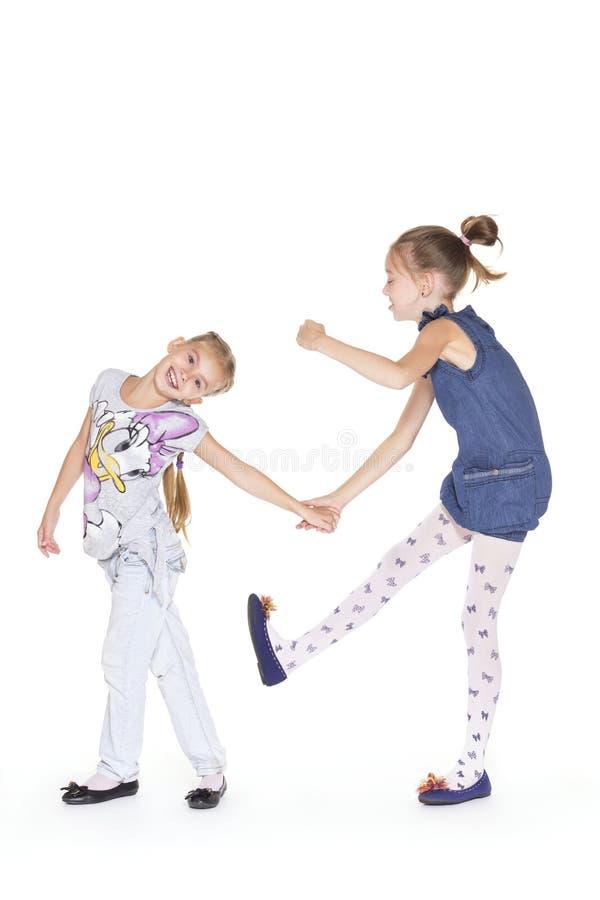 Dansa för två härligt flickor royaltyfria bilder