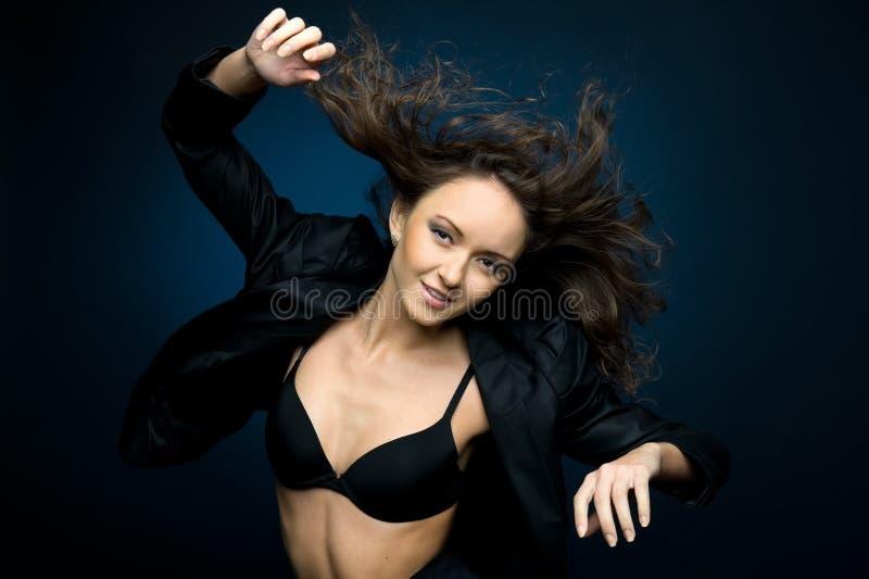 dansa flyaway hårkvinna royaltyfria foton