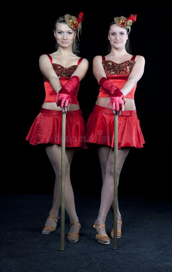 dansare klär red två royaltyfri foto