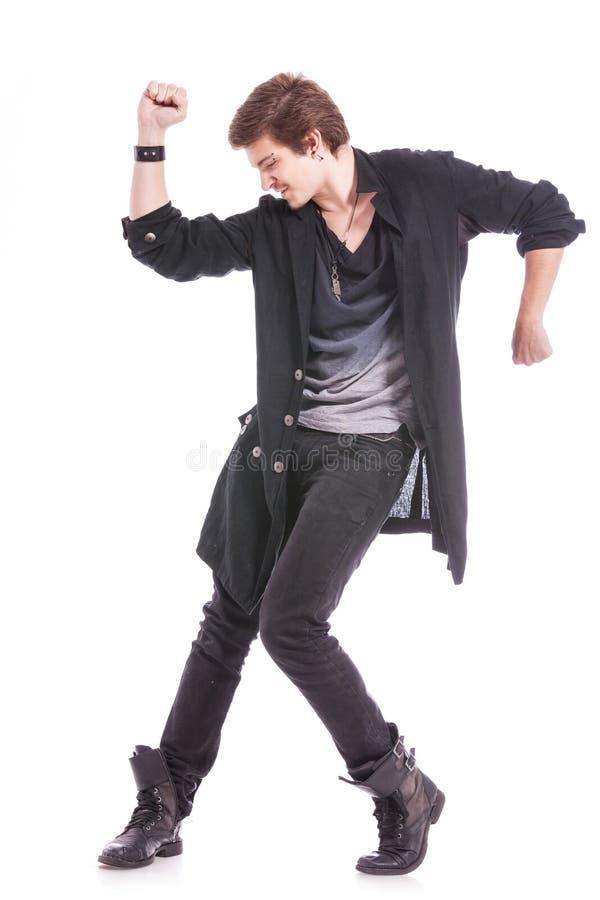 Dansare med räcker upp böjelse & besegrar arkivfoton