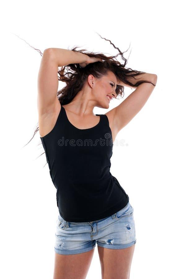 Danse de femme avec le cheveu bouclé image libre de droits
