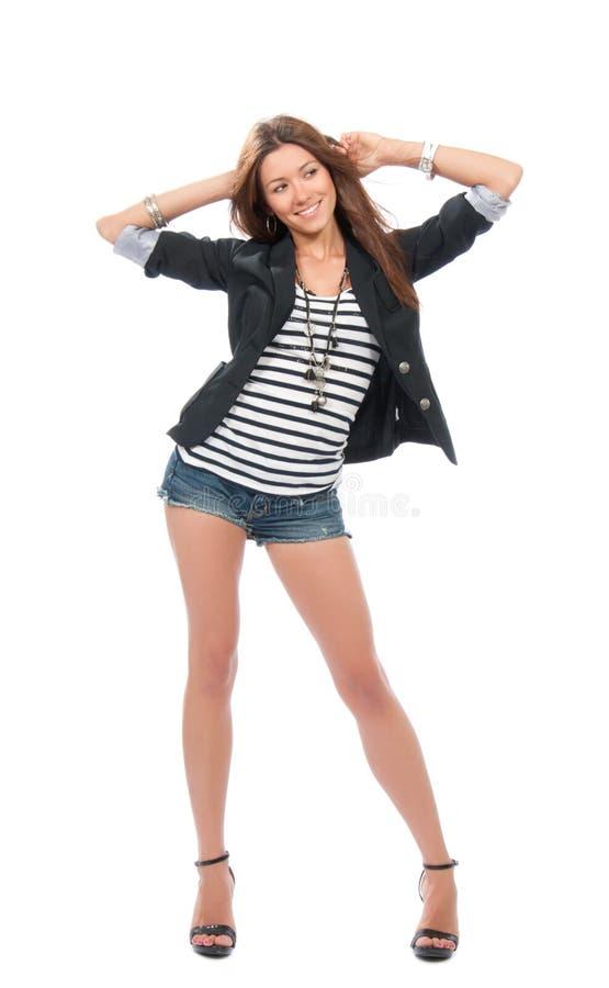 Danse de femme de Brunette en tissu occasionnel image stock