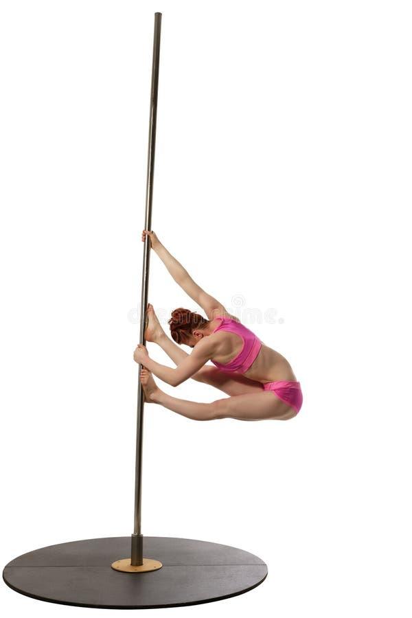 Danse de Polonais Femme rousse s'exerçant sur le pylône images stock