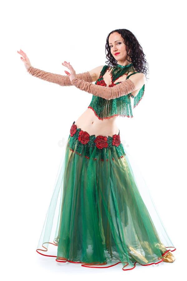 Danse de ventre sexy de danse de fille D'isolement sur un fond blanc image libre de droits